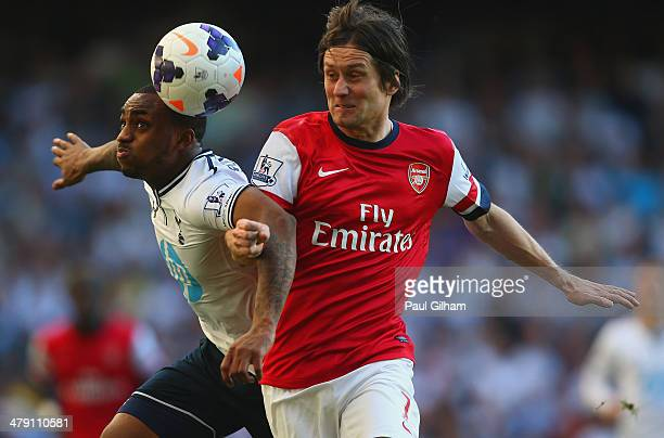 Danny Rose of Tottenham Hotspur and Tomas Rosicky of Arsenal battle for the ball during the Barclays Premier League match between Tottenham Hotspur...