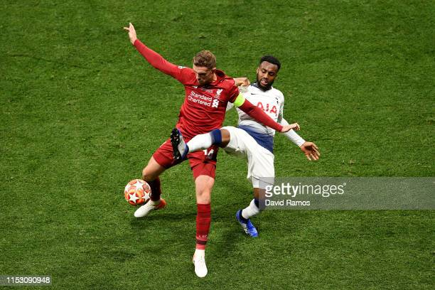 Danny Rose of Tottenham Hotspur battles for possession with Jordan Henderson of Liverpool during the UEFA Champions League Final between Tottenham...