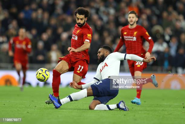 Danny Rose of Tottenham Hotspur battles for possession with Mohamed Salah of Liverpool during the Premier League match between Tottenham Hotspur and...