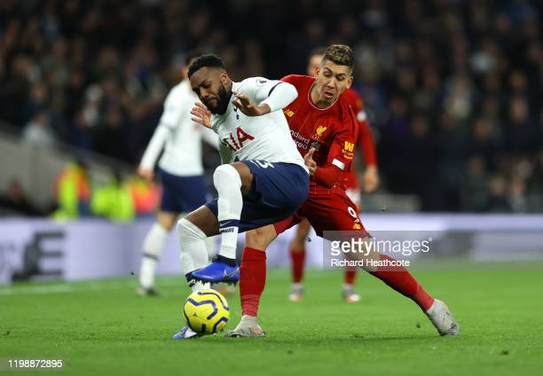 Danny Rose of Tottenham Hotspur battles for possession with Roberto Firmino of Liverpool during the Premier League match between Tottenham Hotspur...