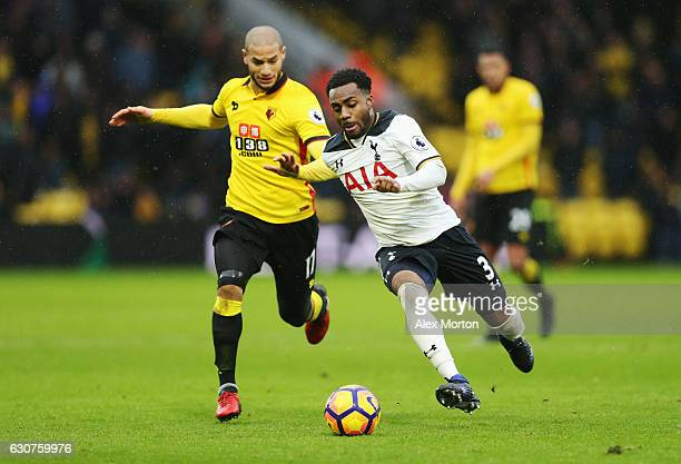 Danny Rose of Tottenham Hotspur battles with Adlene Guedioura of Watford during the Premier League match between Watford and Tottenham Hotspur at...