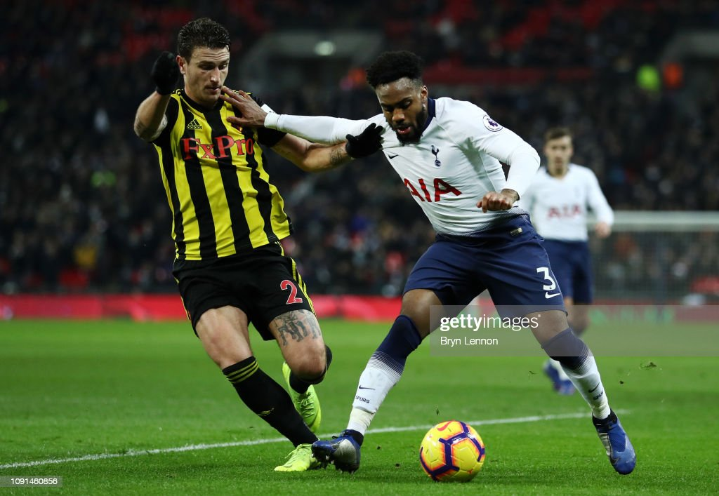 Danny Rose Of Tottenham Hotspur Holds Off Daryl Janmaat Of