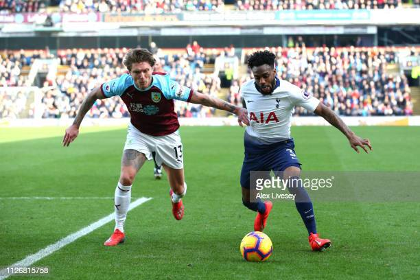 Danny Rose of Tottenham Hotspur is challenged by Jeff Hendrick of Burnley during the Premier League match between Burnley FC and Tottenham Hotspur at...