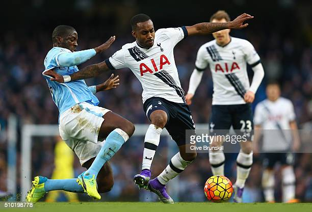 Danny Rose of Tottenham Hotspur is challenged by Yaya Toure of Manchester City during the Barclays Premier League match between Manchester City and...