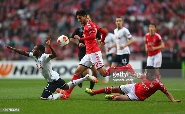 Danny Rose of Tottenham Hotspur is fouled by Eduardo Salvio of SL Benfica as Andre Gomes looks on during the UEFA Europa League Round of 16 2nd leg...