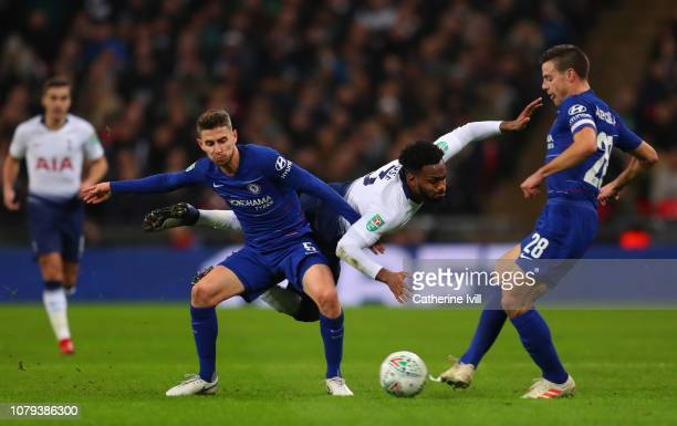 Danny Rose of Tottenham Hotspur is fouled by Jorginho of Chelsea and Cesar Azpilicueta of Chelsea during the Carabao Cup SemiFinal First Leg match...