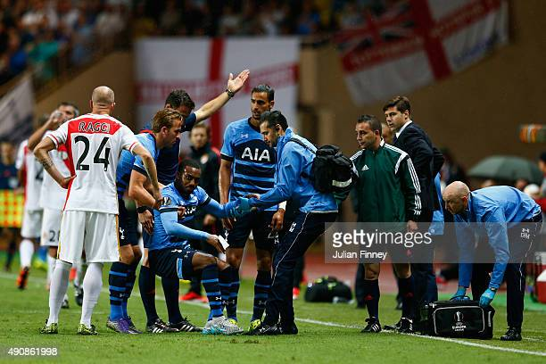 Danny Rose of Tottenham Hotspur is helped to his feet during the UEFA Europa League group J match between AS Monaco FC and Tottenham Hotspur FC at...