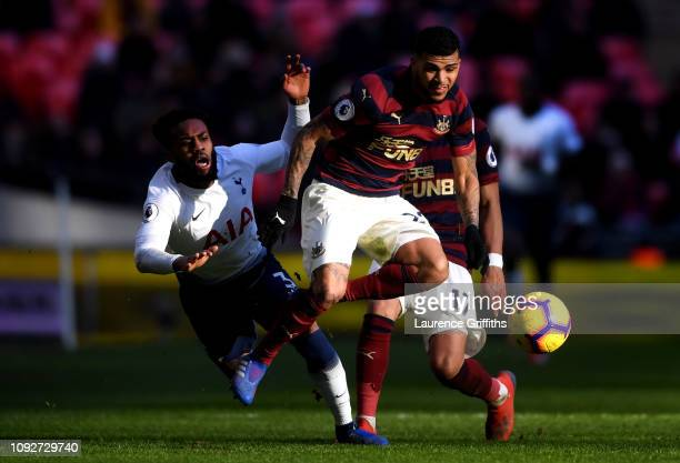 Danny Rose of Tottenham Hotspur is tackled by Deandre Yedlin of Newcastle United during the Premier League match between Tottenham Hotspur and...