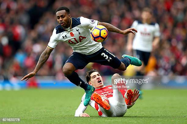 Danny Rose of Tottenham Hotspur is tackled by Hector Bellerin of Arsenal during the Premier League match between Arsenal and Tottenham Hotspur at...