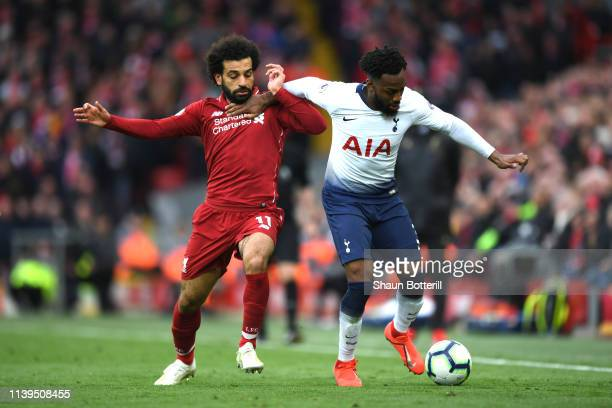 Danny Rose of Tottenham Hotspur is tackled by Mohamed Salah of Liverpool during the Premier League match between Liverpool FC and Tottenham Hotspur...