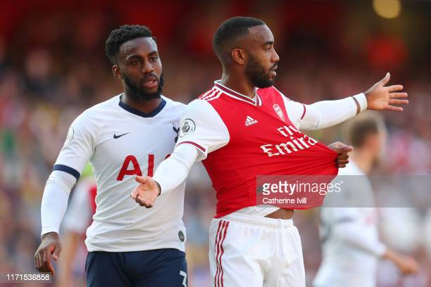 Danny Rose of Tottenham Hotspur pulls the shirt of Alexandre Lacazette of Arsenal during the Premier League match between Arsenal FC and Tottenham...
