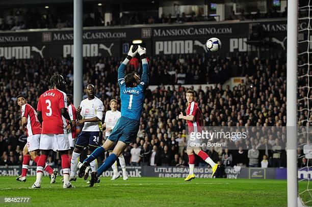Danny Rose of Tottenham Hotspur scores on his Premier League past goalkeeper Manuel Almunia of Arsenal during the Barclays Premier League match...
