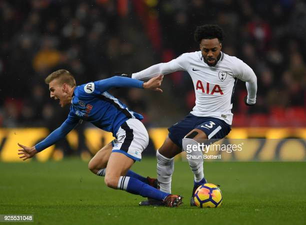 Danny Rose of Tottenham Hotspur skips past Joseph Rafferty of Rochdale during the Emirates FA Cup Fifth Round Replay match between Tottenham Hotspur...