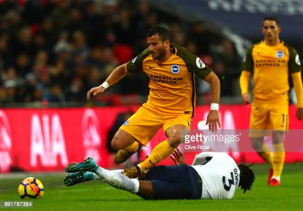 Danny Rose of Tottenham Hotspur tackles Tomer Hemed of Brighton and Hove Albion during the Premier League match between Tottenham Hotspur and...