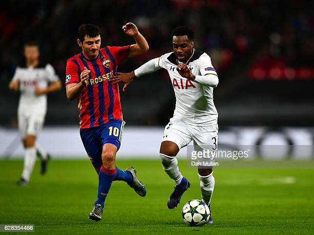Danny Rose of Tottenham Hotspur takes the ball past Alan Dzagoev of CSKA Moscow during the UEFA Champions League Group E match between Tottenham...