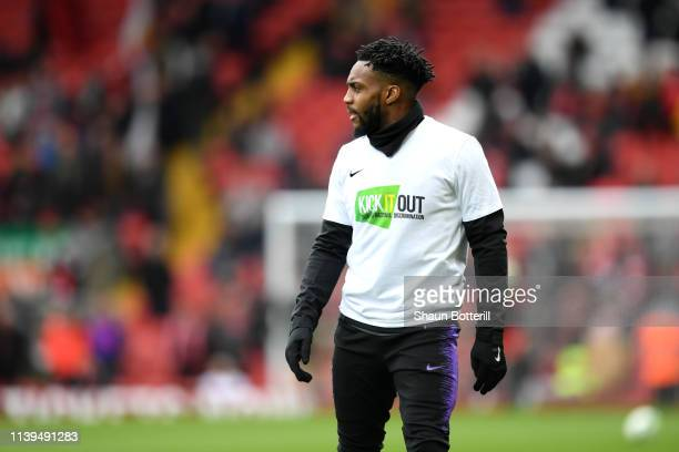 Danny Rose of Tottenham Hotspur warms up ahead of the Premier League match between Liverpool FC and Tottenham Hotspur at Anfield on March 31 2019 in...