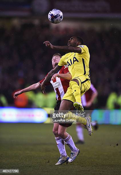 Danny Rose of Tottenham Hotspur wins a header with Louis Reed of Sheffield United during the Capital One Cup SemiFinal Second Leg match between...