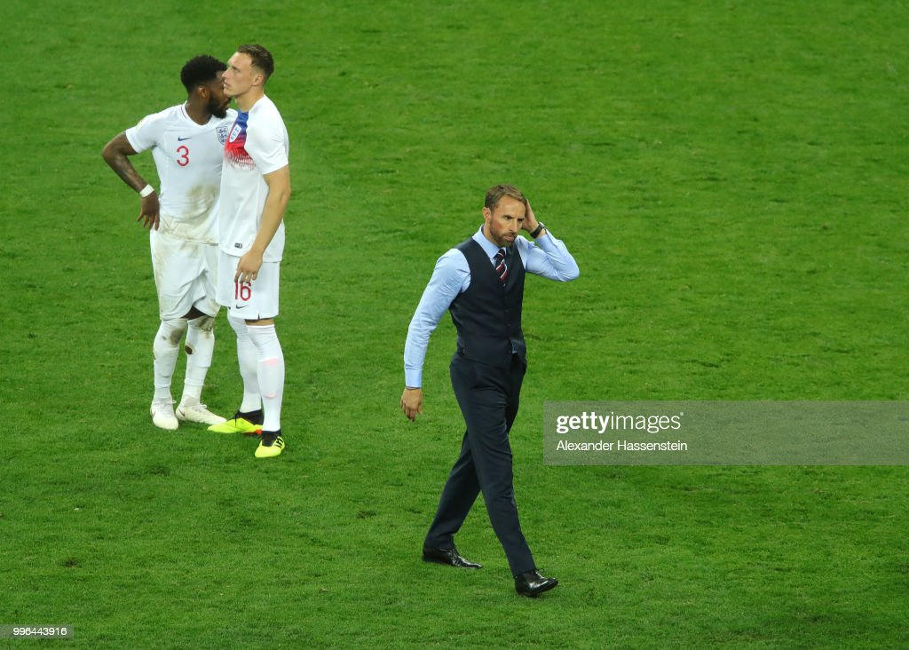 Danny Rose, Phil Jones and Gareth Southgate of England show their dejection following the 2018 FIFA World Cup Russia Semi Final match between England and Croatia at Luzhniki Stadium on July 11, 2018 in Moscow, Russia.