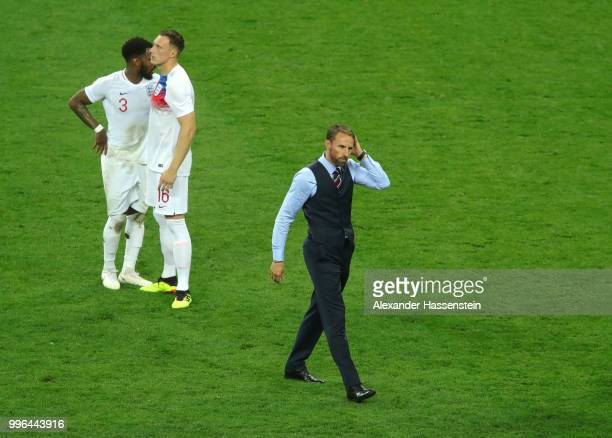Danny Rose, Phil Jones and Gareth Southgate of England show their dejection following the 2018 FIFA World Cup Russia Semi Final match between England...