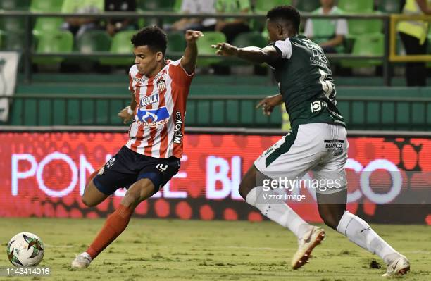 Danny Rosero Valencia of Cali vies for the ball with Luis Diaz of Junior during a match between Deportivo de Cali and Junior as part of Torneo...
