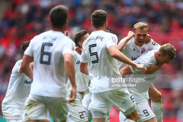 Danny Rowe of AFC Flyde celebrates with his team mates after scoring his team's first goal during the FA Trophy Final match between Leyton Orient and...