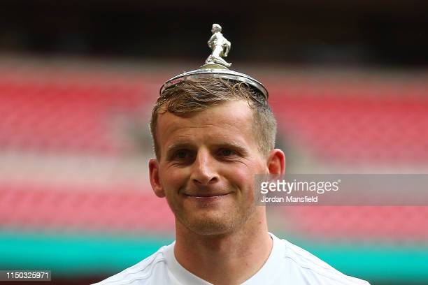 Danny Rowe of AFC Flyde celebrates with the cover of the trophy on his head at the end of the FA Trophy Final match between Leyton Orient and AFC...