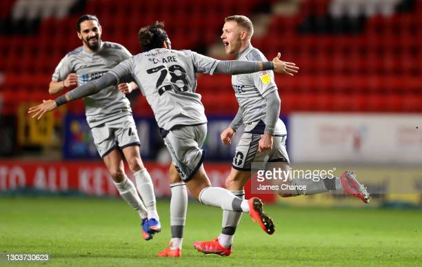 Danny Rowe of Burton Albion celebrates with Ryan Edwards and Sean Clare after scoring his sides second goal during the Sky Bet League One match...