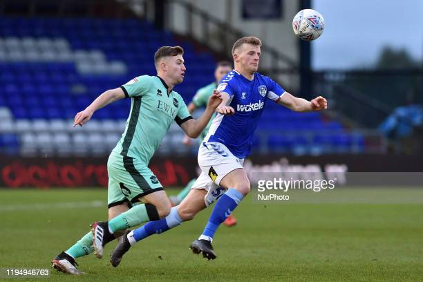 Danny Rowe of Oldham Athletic and Elliot Watt of Carlisle United in action during the Sky Bet League 2 match between Oldham Athletic and Carlisle...