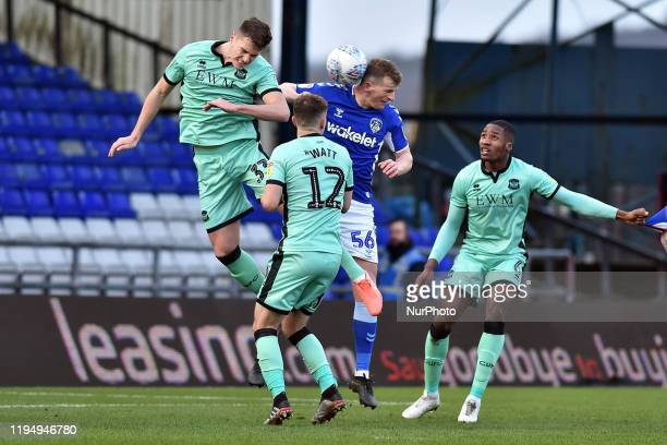Danny Rowe of Oldham Athletic and Max Hunt of Carlisle United during the Sky Bet League 2 match between Oldham Athletic and Carlisle United at...