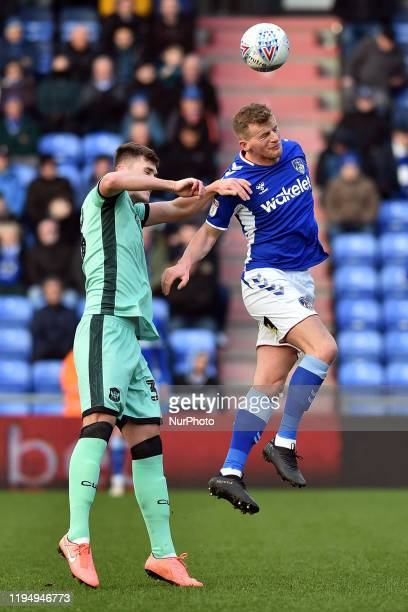 Danny Rowe of Oldham Athletic and Max Hunt of Carlisle United in action during the SkyBet League 2 Game at Boundary Park Oldham on Saturday 18th...