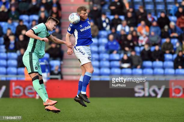 Danny Rowe of Oldham Athletic and Max Hunt of Carlisle United in action during the Sky Bet League 2 match between Oldham Athletic and Carlisle United...