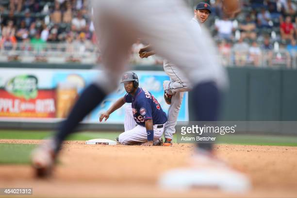 Danny Santana of the Minnesota Twins looks back at first after being tagged out by Ian Kinsler of the Detroit Tigers in the fifth inning at Target...