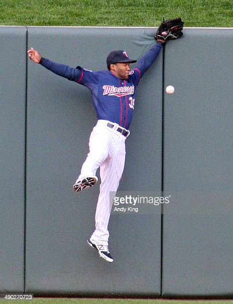 Danny Santana of the Minnesota Twins misses a hit by Xander Bogaerts of the Boston Red Sox run in the second inning and the Twins beat the Red Sox...
