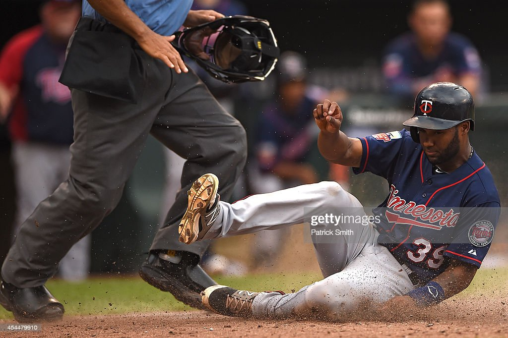 Danny Santana #39 of the Minnesota Twins slides safe into home plate against the Baltimore Orioles in the eighth inning at Oriole Park at Camden Yards on September 1, 2014 in Baltimore, Maryland. The Minnesota Twins won, 6-4.