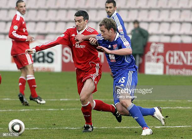 Danny Schwarz of FC Bayern II and Manuel Konrad of Unterhaching battle for the ball during the 3Liga match between SpVgg Unterhaching and Bayern...