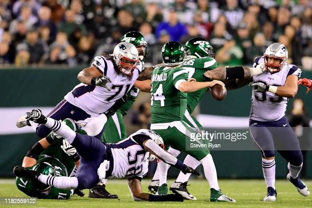Danny Shelton of the New England Patriots is called for roughing the passer as he hits Sam Darnold of the New York Jets during the first half at...