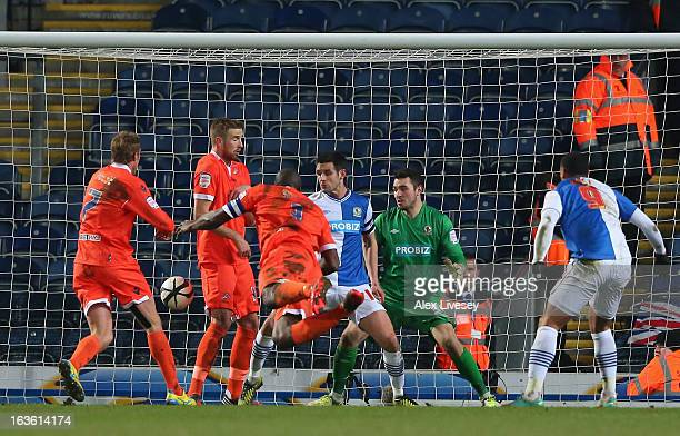 Danny Shittu of Millwall scores the opening goal during the FA Cup sponsored by Budweiser Sixth Round Replay match between Blackburn Rovers and...