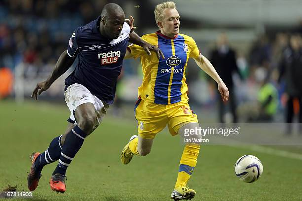 Danny Shittu of Millwall tries to tackle Jonathan Williams of Crystal Palace the npower Championship match between Millwall and Crystal Palace at The...