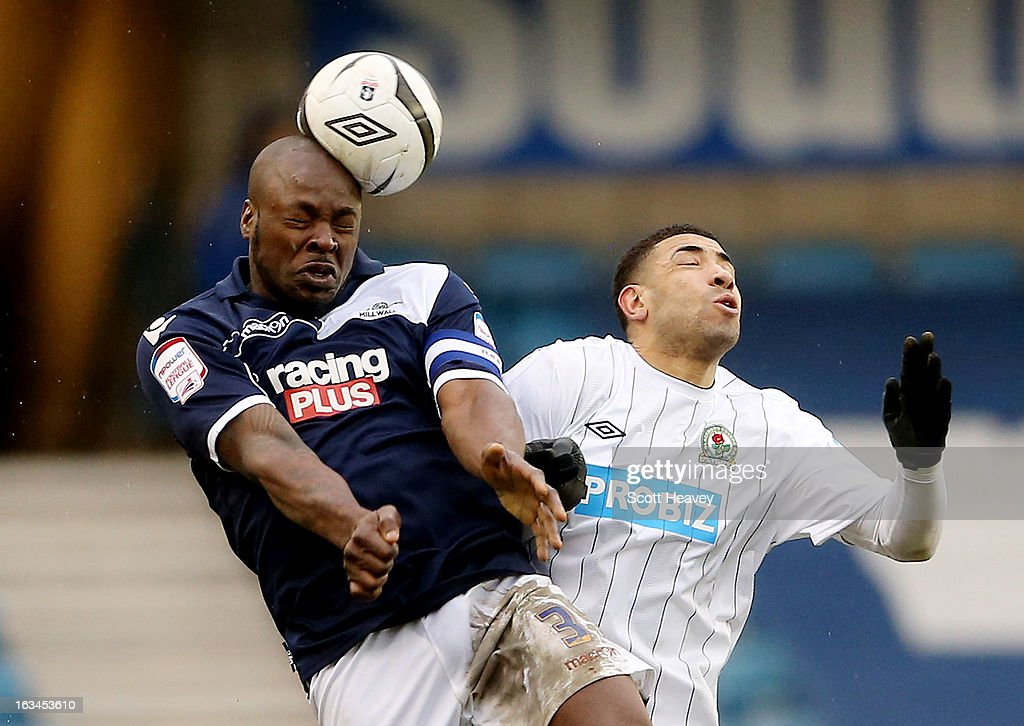 Danny Shittu of Millwall (L) wins the header against Leon Best of Blackburn during the FA Cup Sixth round match between Millwall and Blackburn Rovers at The Den on March 10, 2013 in London, England.