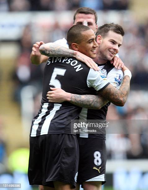 Danny Simpson and Danny Guthrie of Newcastle United celebrate the opening goal during the Barclays Premier League match between Newcastle United and...