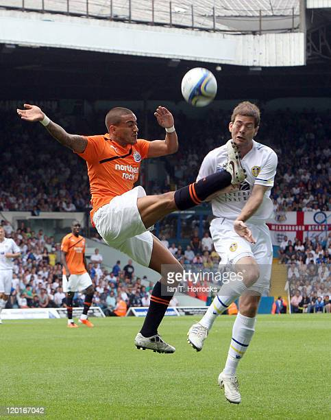 Danny Simpson clears the ball from Ben Parker during a Preseason friendly match between Leeds United and Newcastle United at the Elland Road on July...