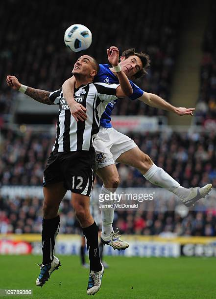 Danny Simpson od Newcastle battles with Leighton Baines of Everton during the Barclays Premier League match between Newcastle United and Everton at...