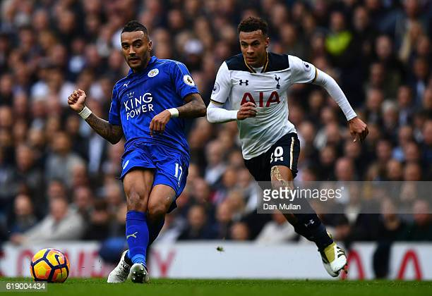 Danny Simpson of Leicester City and Dele Alli of Tottenham Hotspur compete for the ball during the Premier League match between Tottenham Hotspur and...