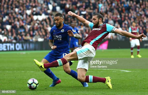Danny Simpson of Leicester City attempts to block Andy Carroll of West Ham United shot during the Premier League match between West Ham United and...