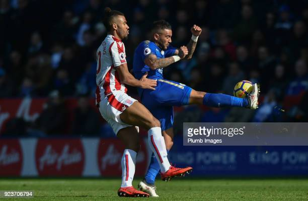 Danny Simpson of Leicester City clears the ball ahead of Maxim Choupo Moting of Stoke City during the Premier League match between Leicester City and...