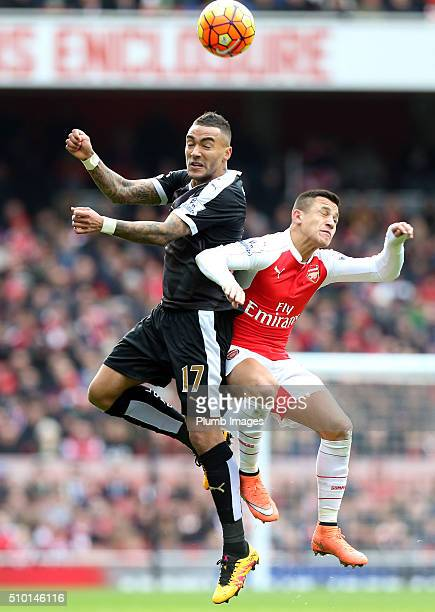 Danny Simpson of Leicester City in action with Alexis Sanchez of Arsenal during the Premier League match between Arsenal and Leicester City at...
