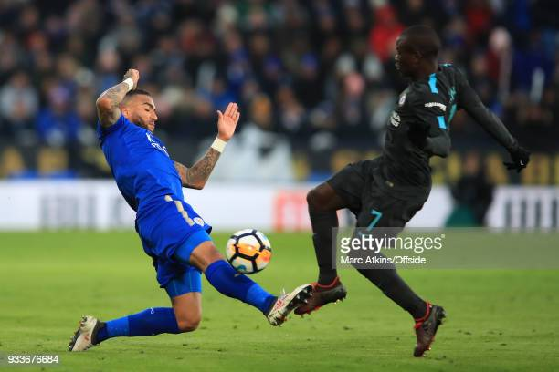Danny Simpson of Leicester City in action with N'Golo Kante of Chelsea during the Emirates FA Cup Quarter Final match between Leicester City and...