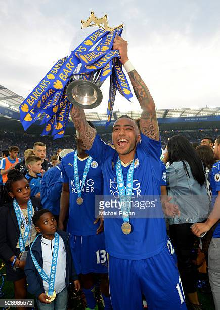 Danny Simpson of Leicester City lifts the Premier League Trophy as players and staffs celebrate the season champion after the Barclays Premier League...