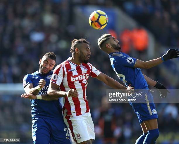 Danny Simpson of Leicester Maxim ChoupoMoting of Stoke and Riyad Mahrez of Leicester in action during the Premier League match between Leicester City...