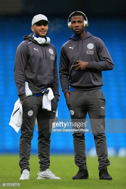 Danny Simpson of Leicester stands alongside teammate Kelechi Iheanacho of Leicester before the Premier League match between Manchester City and...
